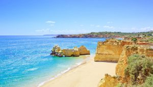 Beach and rock formation known as Praia da Rocha in travel destination Portimao. Algarve, Portugal, Europe.