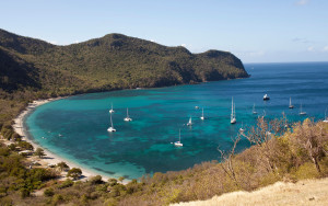 CF1B2E Sail boats are moored in the well protected Chatham Bay on Union Island.